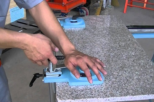 Man Clamping The Stone For Angle Grinder