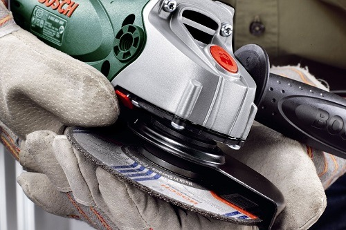 Small Angle Grinder In Hands
