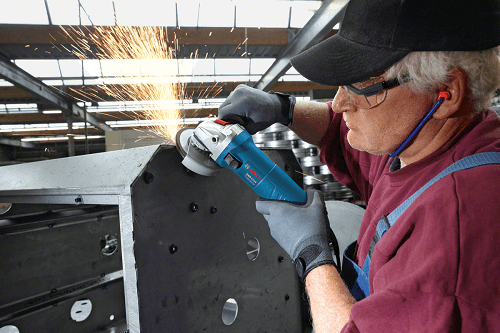 Man Wearing Safety While Using Angle Grinder